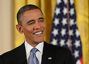 11/14/12 1:58:20 PM -- Washington, DC, U.S.A  --  President Obama smiles as he answers a question during his first press conference since reelection.    Photo by H. Darr Beiser, USA TODAY Staff  ORG XMIT: HB 42697  11/14/2012  (Via OlyDrop)
