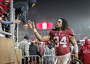 PALO ALTO, CA - NOVEMBER 26:  Peter Kalambayi #34 of the Stanford Cardinal greets fans after an NCAA football game against the Rice Owls played on November 26, 2016 at Stanford Stadium in Palo Alto, California.   (Photo by David Madison/Getty Images)