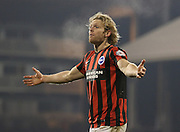 Brighton's Craig Mackail-Smith disputes a decision during the Sky Bet Championship match between Fulham and Brighton and Hove Albion at Craven Cottage, London, England on 29 December 2014. Photo by Phil Duncan.