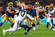 Cincinnati Bengals Defensive Back B.W. Webb (23)  tackles LA Rams Tight End Tyler Higbee (89) during the International Series match between Los Angeles Rams and Cincinnati Bengals at Wembley Stadium, London, England on 27 October 2019.