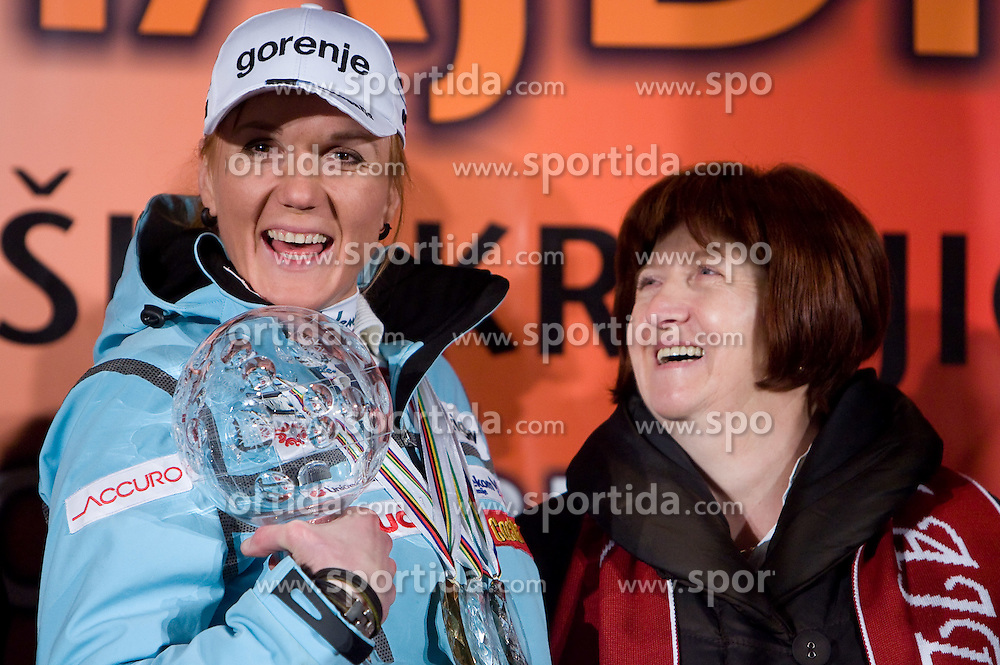Slovenian athlete Petra Majdic celebrates with her mother at her home town when she arrived home with small cristal globus at the end of the nordic season 2008/2009, on March 24, 2009, in Dol pri Ljubljani, Slovenia. (Photo by Vid Ponikvar / Sportida)
