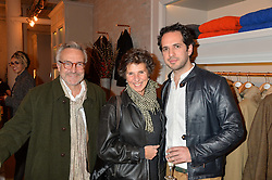 Left to right, STEPHEN BAYLEY, his wife FLO BAYLEY and JAMES EDEN at the launch of the Private White VC flagship store, 73 Duke Street, London on 11th December 2014.