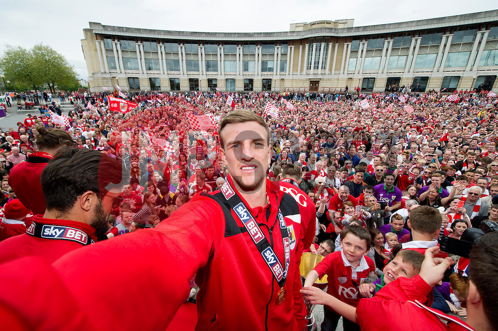 Bristol City's Aden Flint takes a selfie in front of the thousands of fans gathered at the amphitheatre in Bristol  - Photo mandatory by-line: Joe Meredith/JMP - Mobile: 07966 386802 - 04/05/2015 - SPORT - Football - Bristol -  - Bristol City Celebration Tour