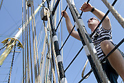 Piotr Krzystek (Major of Szczecin) climbs to the highest yard sailing (sky yard) of Kruzenshtern from Russia during The Tall Ships Races 2013 on Odra River in Szczecin, Poland.<br /> <br /> Poland, Szczecin, August 05, 2013<br /> <br /> Picture also available in RAW (NEF) or TIFF format on special request.<br /> <br /> For editorial use only. Any commercial or promotional use requires permission.<br /> <br /> Mandatory credit:<br /> Photo by &copy; Adam Nurkiewicz / Mediasport