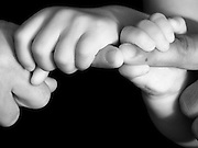 Family Hands Father and child's interlocked hands in black and white