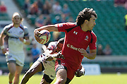 Twickenham. UK. Canadian, Nathan HIRAYAMA, looks for a passs to move th ball on, Cup Quater Final. USA vs Canada  during the 2015. Marriott London Sevens. RFU Twickenham Stadium. Surrey. 16.05.2015. [Mandatory Credit: Peter Spurrier/Intersport Images]