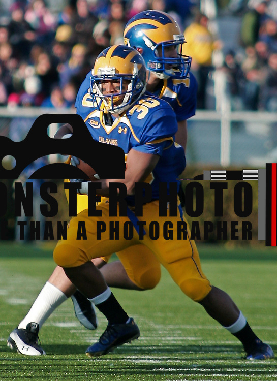 Delaware QB (#17) Pat Devlin hands off to RB (#30) Andrew Pierce, Pierce would score two touchdowns and go over 1,000 yards for the season with 79 rushing yards. Delaware defeated Towson 48-0 on a brisk Saturday afternoon at Delaware stadium in Newark Delaware...Delaware improves to 8-1, Delaware will travel to Massachusetts to face the minute men of UMass Nov 13.