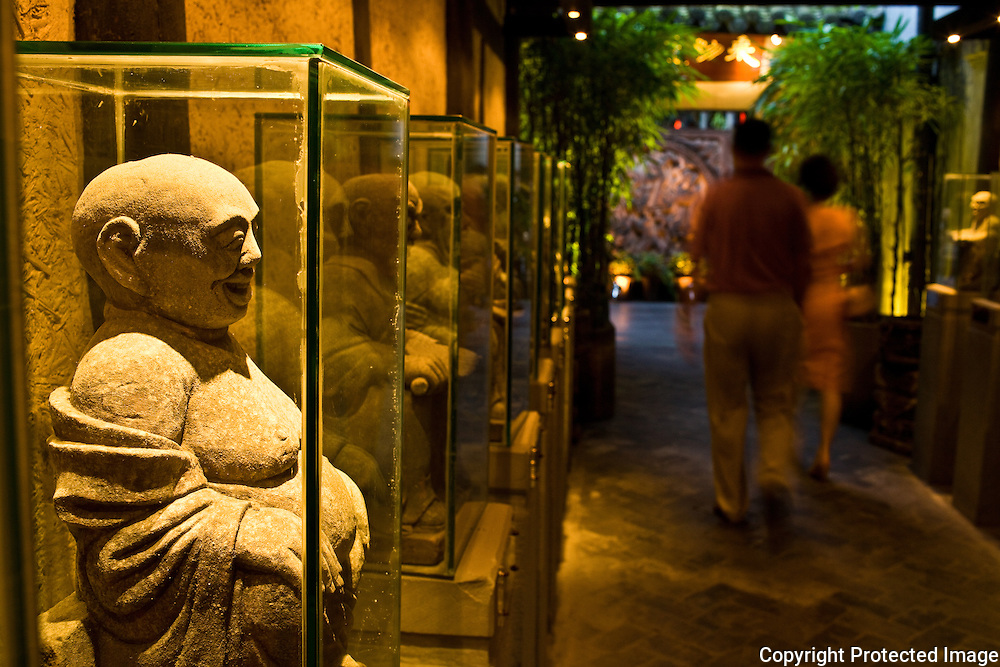 Zi Fei entrance; statue-lined corridor leads from double doors to courtyard