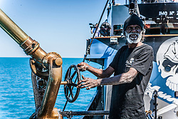 Goolarabooloo Traditional owner Richard Hunter behind the wheel of The Steve Irwin's water canon off James Price Point on the Kimberley coast.