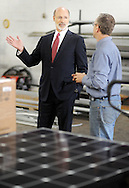 Pennsylvania Governor Tom Wolf (left) speaks with Exact Solar owner Mark Bortman while touring their warehouse and called for the legislature to pass a minimum wage increase Monday April 4, 2016 at the Exact Solar warehouse in Newtown, Pennsylvania. (Photo by William Thomas Cain)