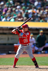 OAKLAND, CA - JUNE 21:  Johnny Giavotella #12 of the Los Angeles Angels of Anaheim at bat against the Oakland Athletics during the ninth inning at O.co Coliseum on June 21, 2015 in Oakland, California. The Oakland Athletics defeated the Los Angeles Angels of Anaheim 3-2. (Photo by Jason O. Watson/Getty Images) *** Local Caption *** Johnny Giavotella