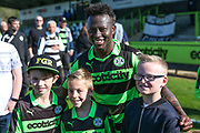 Forest Green Rovers Drissa Traoré(4) with FGR fans after the match during the Vanarama National League Play Off second leg match between Forest Green Rovers and Dagenham and Redbridge at the New Lawn, Forest Green, United Kingdom on 7 May 2017. Photo by Shane Healey.