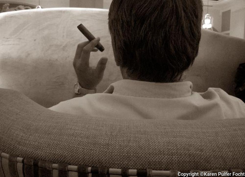 John Focht enjoys a cigar.