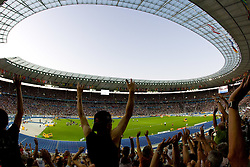 Spectators attend the 12th IAAF World Athletics Championships at the Olympic Stadium on August 20, 2009 in Berlin, Germany. (Photo by Vid Ponikvar / Sportida)
