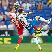 BARCELONA, SPAIN - August 18:  Luuk De Jong #19 of Sevilla and Lluis Lopez Marmol #6 of Espanyol challenge for the ball during the Espanyol V  Sevilla FC, La Liga regular season match at RCDE Stadium on August 18th 2019 in Barcelona, Spain. (Photo by Tim Clayton/Corbis via Getty Images)