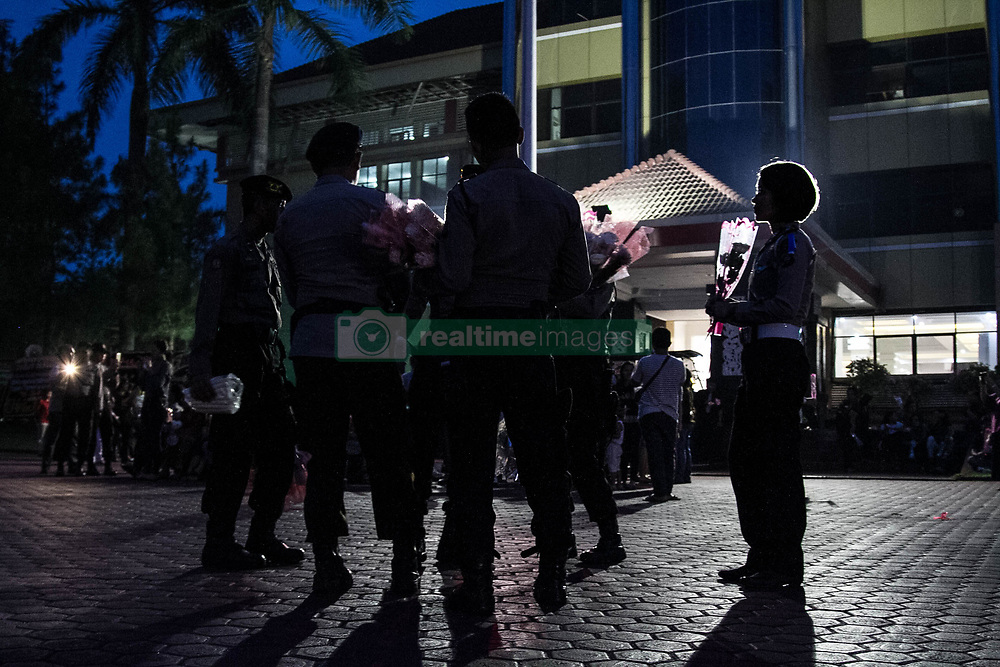 June 27, 2017 - Medan, North Sumatra, Indonesia - Police Indonesia as relatives brought his flower to Martua Sigalingging, the policeman who died at the North Sumatra Police headquarters after the attack on Medan on 26 June 2017, Indonesia. Two suspected militants were Syawaluddin Pakpahan, Ardial Ramadhana (died) gunshot wound to the chest on Sunday attacking provincial police headquarters in Indonesia killing a policeman during the most important Islamic holiday, an official said. (Credit Image: © Ivan Damanik via ZUMA Wire)