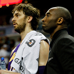 April 9, 2012; New Orleans, LA, USA; Los Angeles Lakers shooting guard Kobe Bryant (24) and power forward Pau Gasol (16) stand for a timeout during the first quarter of a game against the New Orleans Hornets at the New Orleans Arena. The Lakers defeated the Hornets 93-91. Mandatory Credit: Derick E. Hingle-US PRESSWIRE