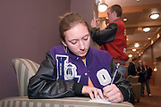 18516Appalachian Scholars Open House reception 12/10/07..Kaci Alexandra Howe from Logan, OH. Fills out the application......Appalachian Scholars program: A Q&A.Information session scheduled tonight.Dec. 10, 2007.By George Mauzy..The Athens campus will host its third annual Appalachian Scholars information session for high school students and parents at 7 p.m. today in the Baker University Center Ballroom. Organizers will outline the program's requirements and answer questions...In anticipation of tonight's event, Outlook asked Associate Provost for Appalachian Access and Enrichment Programs Richard Greenlee to share his thoughts about the program. But first, some background...The Appalachian Scholars award, now in its second year, is a need-based, renewable four-year scholarship award valued at $10,000 each year. It includes an annual book stipend and participation in a yearly leadership seminar...The university has 20 Appalachian Scholars on five campuses, including 12 on the Athens campus and two on each regional campus except Lancaster, which is not in one of Ohio's 29 Appalachian counties. This fall's class of 10 recipients was chosen from more than 150 applicants...Last year's Appalachian Scholars information session, the first large-scale public event held in the new University Center, attracted more than 200 people. A similar crowd is expected tonight...The Eastern campus will host its info session at 6 p.m. Wednesday in Shannon Hall. The Chillicothe and Southern campuses have already held their sessions, and one is expected to be scheduled on the Zanesville campus in January...Why is the Appalachian Scholars program important?..It demonstrates the university's commitment to families and communities in the 29-county region by helping high school students attain a college education...The program teaches students and their families how to navigate the educational experience. It promotes economical sustainability and social mobility by providing the students wit