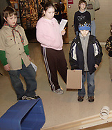Duncan Shalda, 9 (left,) Natalie Shalda, 11 (center,) Brendan Fish, 12 (back right) and Austin Davenport, 6 (front right) watch a demonstration of the momentum ramp at Family Day at the National Museum of the U.S. Air Force, Saturday, January 20, 2007.  Although both rolls on the ramp were released at the same time, and one weighs twice as much, they are at about the same place on the ramp.
