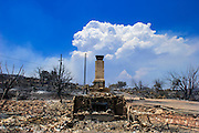 22 JUNE 2005 - CAVE CREEK, AZ:   The chimney is all that remains of a house destroyed by the Cave Creek Complex Fire, a large wild fire which burned northeast of Phoenix. The Cave Creek Complex fire was the third largest wildfire in the state of Arizona to date, after the Rodeo-Chediski fire and Wallow Fire. The fire started on June 21, 2005 by a lightning strike during a monsoon storm and burned 243,950 acres (987.2 km2).   PHOTO BY JACK KURTZ