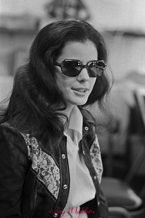 Karen Karsh is a Denver area blind singer, songwriter, and pianist, performing professionally since she was 15. She was photographed in concert at a club in 1974.