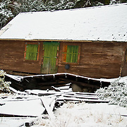 Abandon Cabin Highway 50, CA (near Echo Summit)- Looks like it was knocked off its foundation by snow load. Update as of 2010 the Cabin appears to be gone.