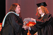 Senior Maxwell Sebastian Mobarry (right) receives his diploma during the Stivers School For The Arts commencement at the Dayton Masonic Center, Saturday, May 19, 2012.