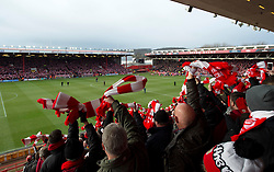 Bristol City fans wave Red and White scarves gifted by Bristol Sport  - Photo mandatory by-line: Joe Meredith/JMP - Mobile: 07966 386802 - 25/01/2015 - SPORT - Football - Bristol - Ashton Gate - Bristol City v West Ham United - FA Cup Fourth Round
