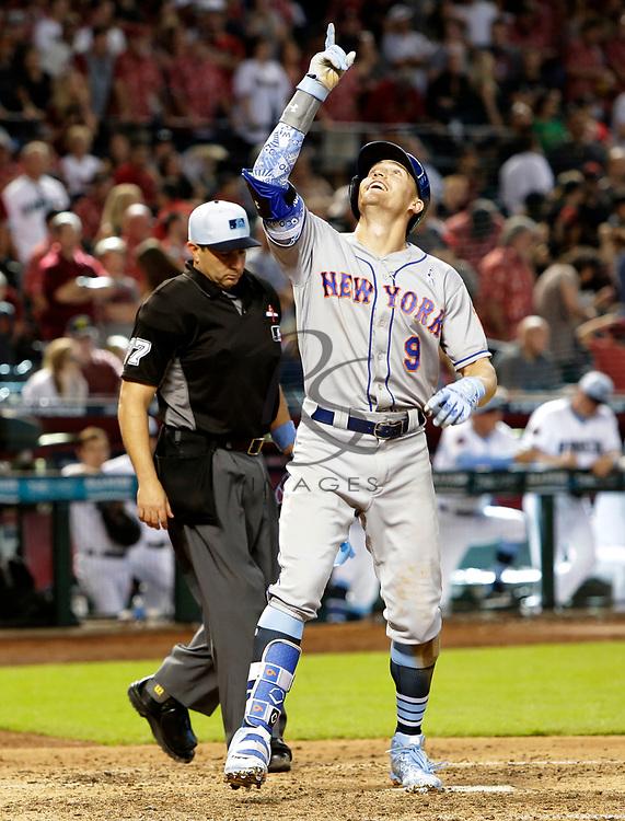 New York Mets' Brandon Nimmo reacts after hitting a two run homerun against the Arizona Diamondbacks in the ninth inning during a baseball game, Sunday, June 17, 2018, in Phoenix. (AP Photo/Rick Scuteri)