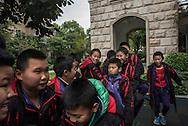Qingyuan, Guangdong, Chine, le 11 mars 2016<br /> Des pensionnaires &agrave; l'heure de la r&eacute;cr&eacute;ation &agrave; L'&eacute;cole de football Evergrande. Fond&eacute;e en 2013, l'&eacute;cole compte plus de 2000 &eacute;l&egrave;ves et pr&egrave;s de 50 terrains de football.<br /> Gilles Sabri&eacute; pour L'Equipe