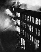 Warehouses in the east of London burning, set alight by bombs dropped from Lufwaffe (German Air Force) planes   during the  Blitz on the night of 24-25 August 1940. London firefighters trying to extinguish flames with hoses. damage.