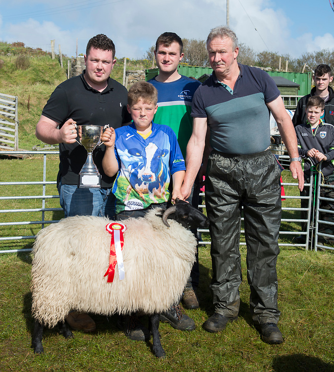 Clare Island Ram Fair &amp; Sheep Dog Trials.<br /> Shane Gallager presents Dylan O'Toole with the Christy Gallagher Memorial Cup for the Overall Champion of the show, also pictured is Christian Pender (Clare Island Ram Fair Committee) and Judge James Lally from Lousiburgh in the parade ring . Pic: Michael Mc Laughlin