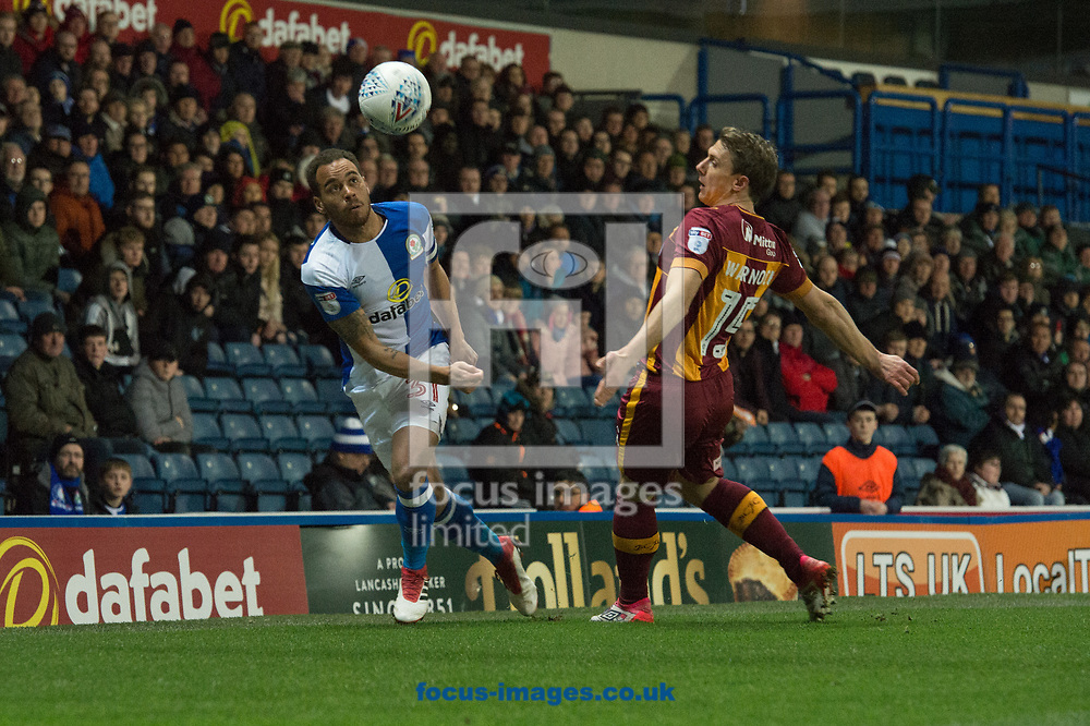 Elliott Bennett of Blackburn Rovers controls the ball ahead of Stephen Warnock of Bradford City during the Sky Bet League 1 match at Ewood Park, Blackburn<br /> Picture by Matt Wilkinson/Focus Images Ltd 07814 960751<br /> 29/03/2018