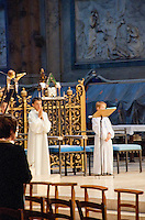 Our Lady of Chartres Cathedral, Chartres, France. Two altar boys dressed in white robes.