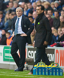 WIGAN, ENGLAND - Sunday, October 18, 2009: Manchester City's manager Mark Hughes and Wigan Athletic's manager Roberto Martinez during the Premiership match at the JJB Stadium. (Pic by David Rawcliffe/Propaganda)