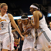 Renee Montgomery, (centre), Connecticut Sun, is congratulated by Kelsey Griffin, (left) and Alex Bentley after hitting a half court buzzer beater as the clock runs down for half time during the Connecticut Sun Vs Phoenix Mercury WNBA regular season game at Mohegan Sun Arena, Uncasville, Connecticut, USA. 12th June 2014. Photo Tim Clayton