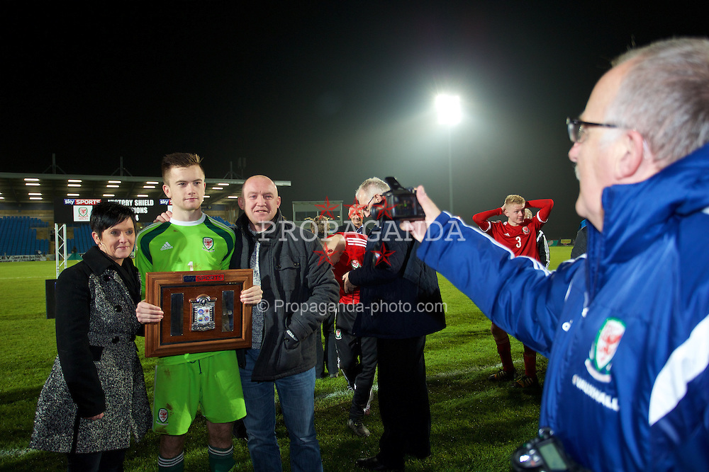 BALLYMENA, NORTHERN IRELAND - Thursday, November 20, 2014: Wales' goalkeeper Scott Coughlan with his parents after winning the Victory Shield with a 2-0 win over Northern Ireland during the Under-16's Victory Shield International match at the Ballymena Showgrounds. (Pic by David Rawcliffe/Propaganda)