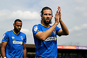 AFC Wimbledon defender George Francomb (7) clapping during the EFL Sky Bet League 1 match between AFC Wimbledon and Doncaster Rovers at the Cherry Red Records Stadium, Kingston, England on 26 August 2017. Photo by Matthew Redman.