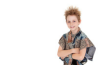 Portrait of pre-teen boy standing with arms crossed over white background