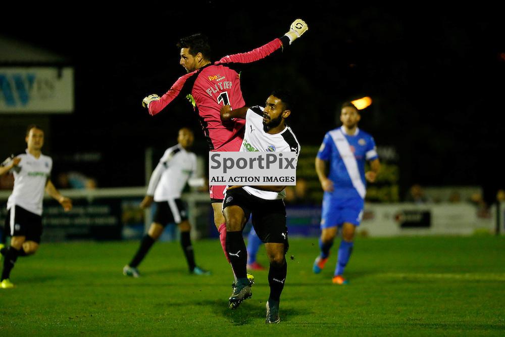 Dover's striker Stefan Payne (23) and Eastleigh's keeper Ross Flitney (1) tangle during the first half. Dover Athletic v Eastleigh. Vanarama National League. 10  November 2015. (c) Matt Bristow | SportPix.org.uk