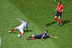 LENS, FRANCE - Thursday, June 16, 2016: Wales' Joe Ledley in action against England's captain Wayne Rooney during the UEFA Euro 2016 Championship Group B match at the Stade Bollaert-Delelis. (Pic by Paul Greenwood/Propaganda)