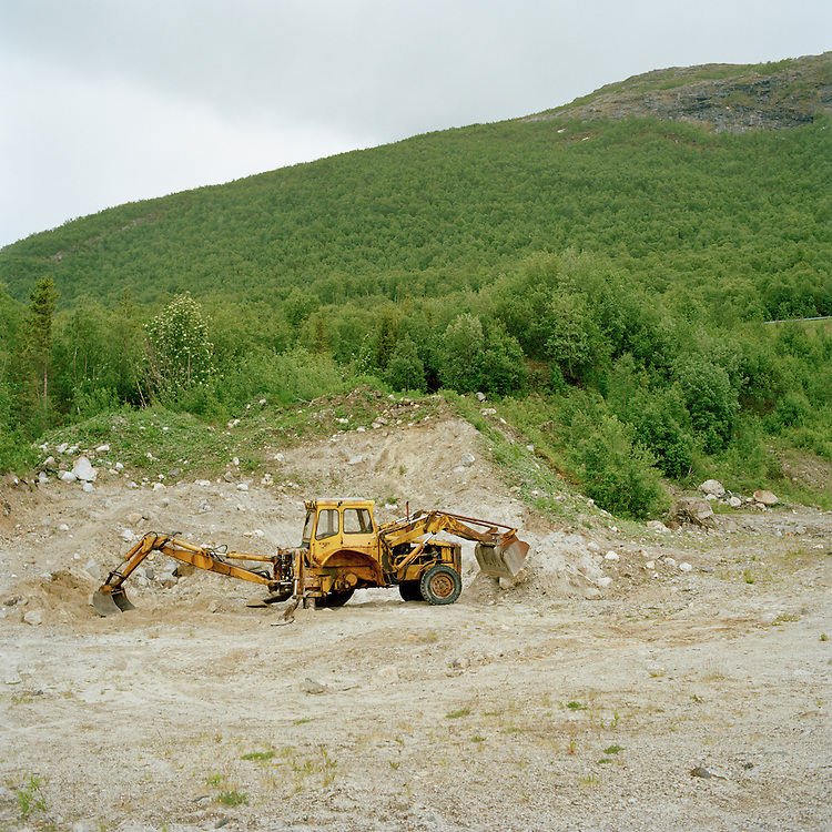 Tractor digger upon the mountain Fjellfjellet, Norway. Fjell means mountain.. ..Photo by Knut Egil Wang /MOMENT