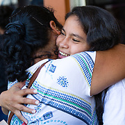 Honduran immigrants deported from the United States arrive on a ICE deportation flight on February 9, 2017 in San Pedro Sula, Honduras. The charter jet arrived from Houston, Texas. Isis greets her mother after arriving home after immigrating to the United States, to avoid a life of crime and violence. U.S. President Donald Trump pledged to vastly increase the number of deportations.