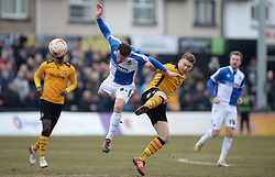 Ollie Clarke of Bristol Rovers wins a high ball over Mark Byrne of Newport County - Mandatory byline: Alex James/JMP - 19/03/2016 - FOOTBALL - Rodney Parade - Newport, England - Newport County v Bristol Rovers - Sky Bet League Two