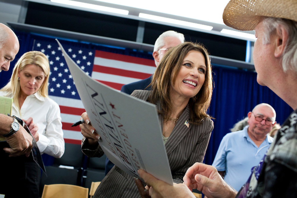 Republican presidential hopeful Michele Bachmann signs autographs at a campaign stop on Saturday, July 23, 2011 in Marshalltown, IA.