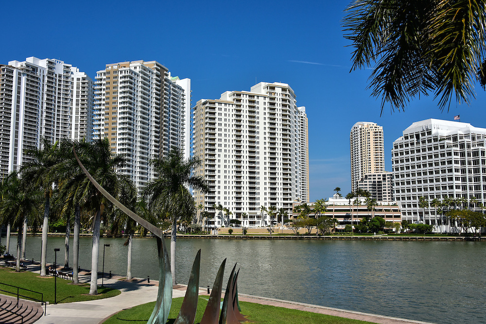 Condo Towers on Brickell Key in Miami, Florida<br /> From the River Walk Trail you are looking across the channel at a few of the dozen high-rise condominium towers on Brickell Key. It is a triangular-shaped island initially created in 1896. Also called the Claughton Island, it is only 44 acres in size yet it has a population of almost 2,200 people. This gated community is just off the coast from downtown Miami and offers spectacular views of Biscayne Bay.