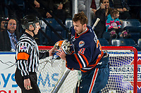 KELOWNA, CANADA - DECEMBER 29: Dylan Ferguson #31 of the Kamloops Blazers receives his helmet from the referee against the Kelowna Rockets on December 29, 2018 at Prospera Place in Kelowna, British Columbia, Canada.  (Photo by Marissa Baecker/Shoot the Breeze)