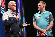 Ryan Harrington is congratulated by his dad Rod Harrington during the Grand Slam of Darts, at Aldersley Leisure Village, Wolverhampton, United Kingdom on 11 November 2019.
