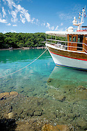 Anchored ship in clear waters of the Mediterranean Sea