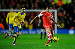 Southampton Midfielder Jack Cork (ENG) is challenged by Arsenal Midfielder Mesut Ozil (GER) - Photo mandatory by-line: Rogan Thomson/JMP - Tel: Mobile: 07966 386802 - 28/01/2014 - SPORT - FOOTBALL - St Mary's Stadium - Southampton v Arsenal - Barclays Premier League.